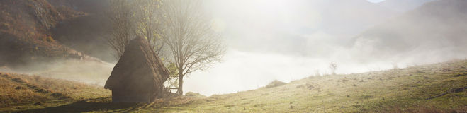 Small cottage in the mountains-panoramic view Stock Image