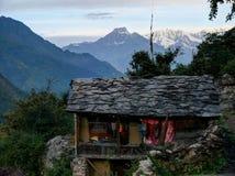 Small cottage in village Chhokang Paro. Baudha Himal (6 672 m n. m.) and Himal Chuli (7 893 m n. m.) from Chhokang Paro village - Morning -Manaslu and Tsum Royalty Free Stock Photo