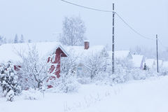 Small cottages covered in snow Royalty Free Stock Photos