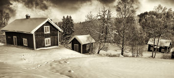 Small cottages in old rural winter landscape Stock Photo