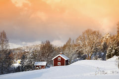 Small cottages in winter landscape Stock Photos