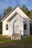 White Country Church against a blue sky. Small country church on a pretty blue sky day Stock Photo