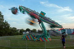 Small Country Fair in Westville. Whirling ride spinning in a blur Stock Photo