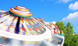 Fair in Westville. Whirling roundup ride spinning by Royalty Free Stock Photos
