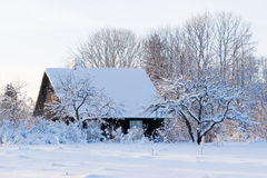 Small country house. In winter landscape Royalty Free Stock Images