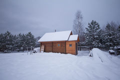 Small country house at winter Stock Photos