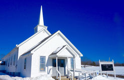 Small country New England church in snowy field Royalty Free Stock Photography
