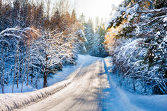 Free Small Country Road In Winter With Sunshine On Snowy Trees Stock Photography - 33222542