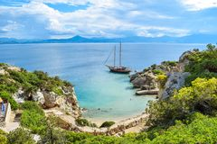 Yacht in small cove. royalty free stock images