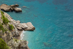 Small cove and turquoise sea on Amalfi coast in Italy Royalty Free Stock Images