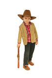 Small cowboy resting hand on weapon toy Royalty Free Stock Image