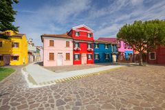 View of the small, cozy courtyard with colorful cottage /  Burano, Venice/ The small yard with bright walls of houses Royalty Free Stock Image