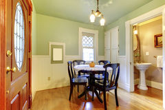 Small and cozy dining room with black wood table chair set and g Stock Photography