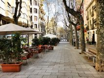 Small cozy empty street cafe in Barcelona, Spain Royalty Free Stock Image