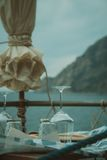 Small cozy restaurant with sea and mountain views. Beautiful table setting in the restaurant overlooking the sea Stock Image