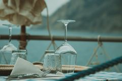 Small cozy restaurant with sea and mountain views. Beautiful table setting in the restaurant overlooking the sea Stock Images