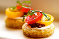 Small Crabcakes. The perfect appetizer or hor dourves sized crab cakes with tomatoes and basil, elegant and scrumptious Royalty Free Stock Photography