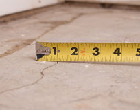 Small crack in cement. Foundation with tape measure Stock Images