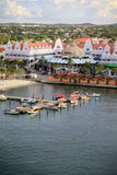 Small craft harbor of Oranjestad, Aruba. Oranjestad, Aruba, harbor with small craft in the foreground and the main Dutch style shopping buildings in the middle Stock Photography