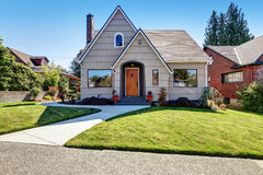 Small craftsman one-story exterior with wood siding. Small American craftsman one-story exterior with wood siding and concrete walkway .Northwest,USA Royalty Free Stock Images