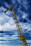 Small crane mounted on a river ship royalty free stock images