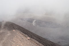 Small crater of Volcano Merapi in clouds Royalty Free Stock Photos