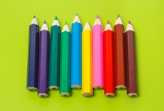 Small crayons in a row in rainbow colors Royalty Free Stock Photography