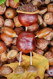 Small creature made of chestnuts and acorns Royalty Free Stock Images
