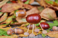 Small creature made of chestnuts and acorns Royalty Free Stock Photography