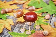 Small creature made of chestnuts and acorns Stock Photo