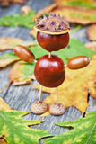 Small creature made of chestnuts and acorns Stock Image