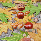 Small creatures made of chestnuts and acorns Royalty Free Stock Photo