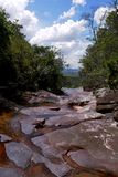 Small creek over red stones stock images