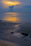 Small creek run into the sea at beautiful sunrise dusk.  Royalty Free Stock Photography