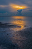 Small creek run into the sea at beautiful sunrise dusk.  Royalty Free Stock Images