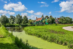 Small creek and rural houses in Zaanse Schans, Netherlands. Stock Photography