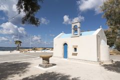 A small Cretan chapel and font on the seafront Royalty Free Stock Images