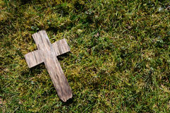 Small cross on grass and moss royalty free stock photo
