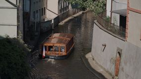 Small cruise boat with tourists in the Vltava river canal in Prague Czech Republic stock video footage