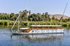 Small cruise boat with two sails on the Nile. Luxury sailing boat for turists on the river nile, Egypt, October 23, 2018 royalty free stock image