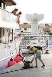 A small cruise ship docking in Vodice, Croatia. Vodice, Croatia - August 11, 2018: A cruise ship Carpe Diem arriving in Vodice and docking. A man and a teenage stock image