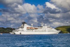 Small cruise ship. Off the BVI island of Virgin Gorda in Caribbean Stock Image