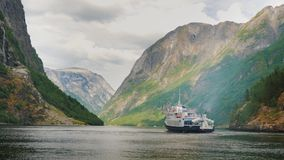 A small cruise ship with tourists begins a trip to the fjord in Norway