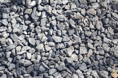 Small crushed stone on the road. Industrial bacjground Royalty Free Stock Images