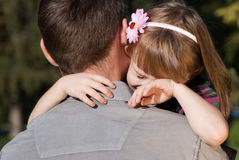 The small crying girl on a shoulder of the father Royalty Free Stock Photo