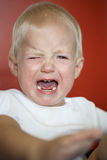 Small, crying toddler in pain after falling down. Learning to walk. Childhood, clumsy phase, hard parenthood concept Stock Photography