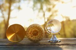 Small crystal globe in front of sunset. travel and global issues concept.  royalty free stock images