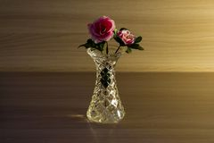 Small crystal vase with a flower. royalty free stock images