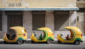 Small cuban taxis in line Stock Photography