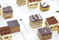 Small cube cake collection Royalty Free Stock Photos